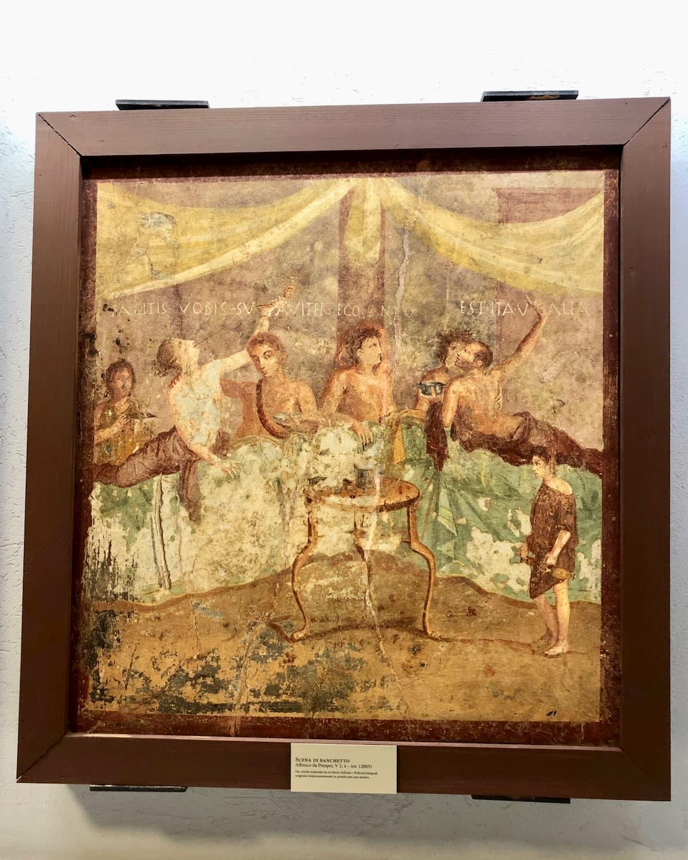 主に男性だけで楽しそうなローマ期ポンペイの饗宴の様子を描いたフレスコ画(ナポリ考古学博物館)